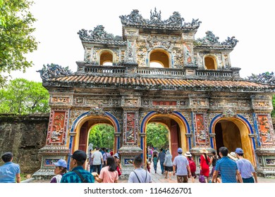 HUE,VIETNAM-JULY 21,2018 : Tourists walk through the door in Hue royal Palace, it was built in 1804. Now is registered as a UNESCO World Heritage Site.