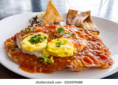 Huevos Rancheros- Classic hispanic dish with eggs, tortilla,salsa, beans and in this Honduran version plantains.