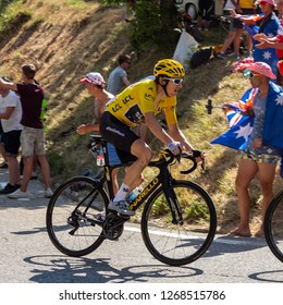 Huez, Auvergne-Rhône-Alpes / France - July 19 2018: Team sky lead the peloton up Alpe d'Huez on the 12th stage of the 2018 tour de France. Geraint Thomas is in the yellow jersey.