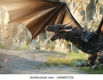 Huge aggressive mystical dragon in move. Creature with big strong wings and powerful paws. He opens terrible mouth with sharp teeth. background to create fabulous collage
