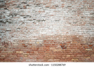 huge ancient brick wall with water stains from Venice, Italy