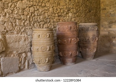 Huge ancient clay vases and camphor. Old dishes, camphor and pitchers. Storage of wine and food. Palace in Knossos, Greece.