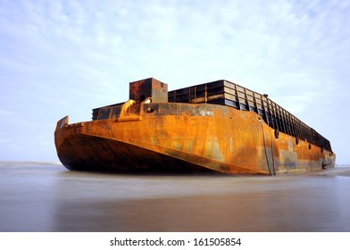 a huge barge stranded at the beach