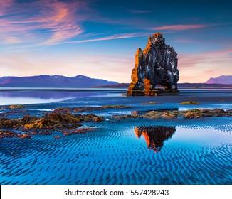 Huge basalt stack Hvitserkur on the eastern shore of the Vatnsnes peninsula. Colorful summer sunrise in northwest Iceland, Europe. Artistic style post processed photo.