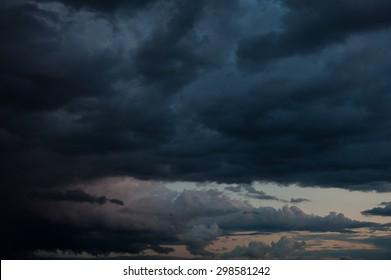 Huge black clouds on sunset