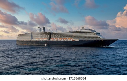 Huge black and white luxury cruise ship sailiing off