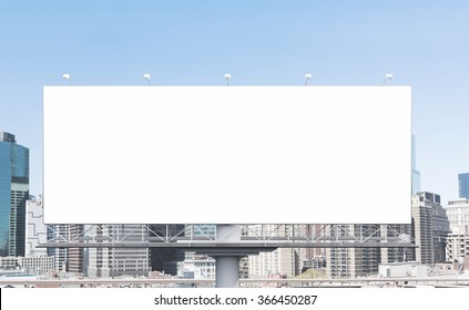 A huge blank billboard in the city centre at daytime. Front view. Concept of outdoor advertising. 3D rendering
