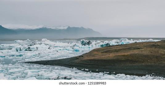 Huge blocks of ice on Glacial river and blue icebergs on Jokulsarlon glacier lake. Vatnajokull National Park, Iceland.
