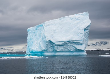 Huge blue iceberg in the antarctic waters