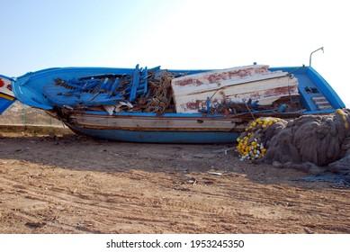 Huge boat broken over the land. Lampedusa, summer 2009.