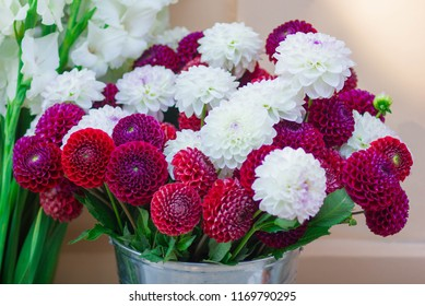 Huge bouquet of red and white dahlias on the white background.Beautiful wedding bouquet. Flowers in bloom.