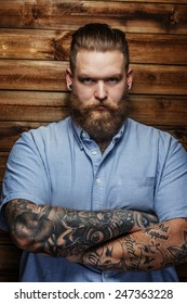 Huge brutal man with beard and tattooes