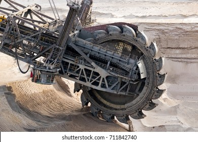 Huge bucket-wheel excavator mining lignite (brown-coal) in an open pit mine.