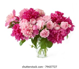 Huge bunch of peonies and cream roses in vase isolated on white