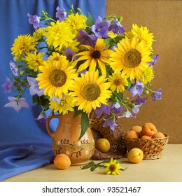 Huge bunch of summer flowers, bluebells, sunflowers and apricots