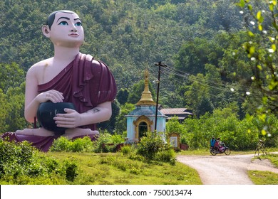 Huge burmese monk statue near the statue Win Sein Taw Ya, the largest Reclining Buddha image in the world, in Kyauktalon Taung, near Mawlamyine, Myanmar.