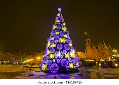 Huge Christmas tree in the city centre at night - Wroclaw, Poland
