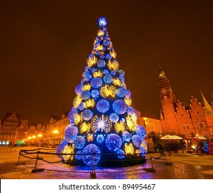 Huge Christmas tree in the city centre at night