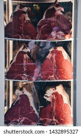 Huge chunks of meat cuts for Florentine steak displayed in a window of a butcher shop in Florence Italy in October of 2018