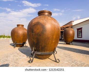 Huge clay wine containers in Alentejo region, Portugal.