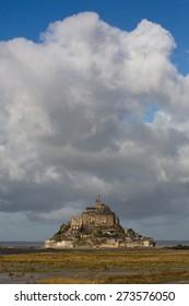 Huge cloud hovering over Mount Saint Michel, France