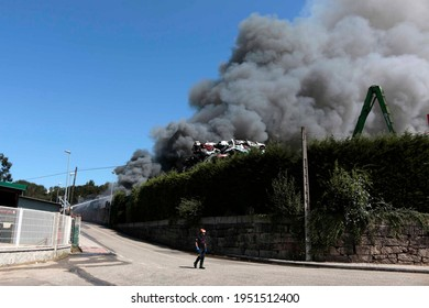Huge cloud of smoke comes out of an industrial fire