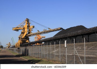 a huge coal loading conveyor belt piles coal. Kooragang Island, Newcastle, NSW, Australia
