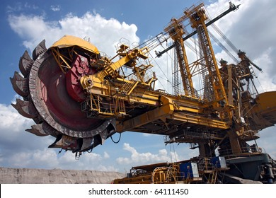 huge coal mining coal machine under cloudy sky
