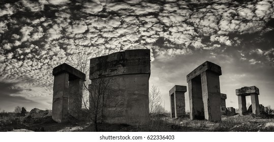 Huge concrete blocks in an abandoned industrial area. Panorama.