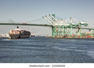 Huge container ship under the historic Vincent Thomas Bridge in San Pedro (Port of Los Angeles)