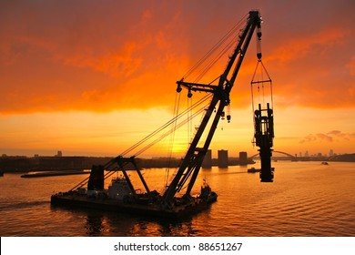 Huge crane barge doing marine heavy lift  installation works in the Port of Rotterdam.