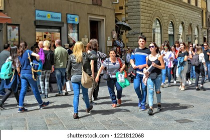 Huge crowd. People walk in the city. Mass tourism. Sightseeing. Tourists on Italian streets. Travel & Vacation. Italy. Florence – April 17, 2018