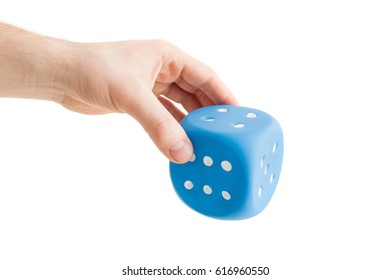 A huge dice in the hands of a man. Waiting for a big win