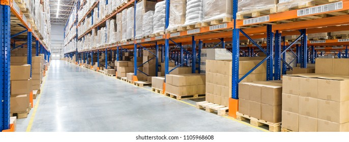 Huge distribution warehouse with high shelves. Bottom view.