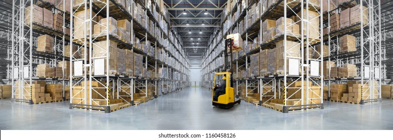 Huge distribution warehouse with high shelves and forklift. Bottom view.