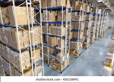 Huge distribution warehouse with high shelves. Top view.