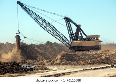 a huge dragline strips overburden to reach the lignite seam in south Texas to provide local base load energy for Texas power plants, along access road to I 37 in Atascosa Co, Tx