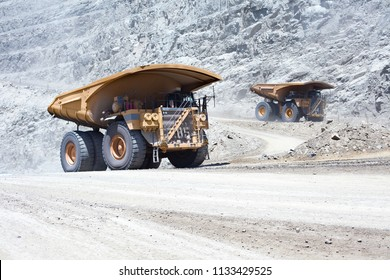 Huge dump trucks in an open pit Copper mine at northern Chile