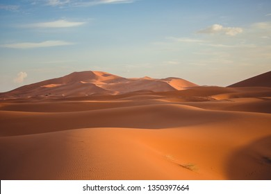 Huge dunes in the Sahara desert under a beautiful blue sky in Erg Chebbi, Morocco