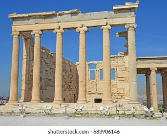 The huge East Porch of the Erectheion, with its high Ionic columns. On the Acropolis of Athens, Greece