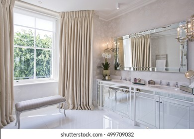 huge en-suite bathroom with luxurious decor