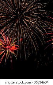 "Huge ""falling-ember"" burst of fireworks above smaller, multicolored burst"