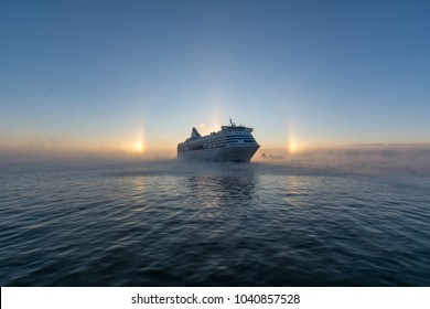 A huge ferry travelling in baltic sea near Helsinki (Finland) with halo sun shining.