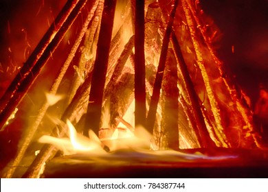 Huge fire at night timber crib fascinating and mesmerizing, primal power