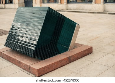Huge giant glass cube on the modern city street. Abstract concept. Classic city elements. Postcard inspiration.