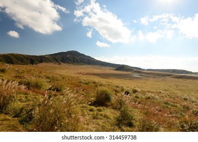 Huge grass field with Mt. Aso ( active volcano in Aso ,Kusasenri) in autumn, Japan