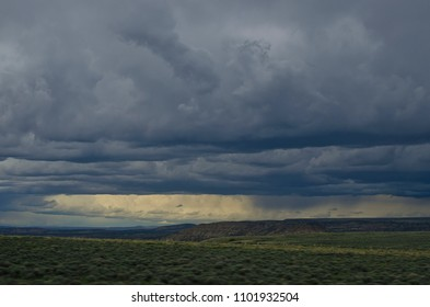 A huge gray storm rolling in on the wyoming open plains.