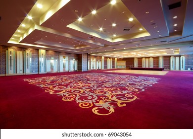 Huge Hall interior with red carpet and ceiling with lights in Hotel