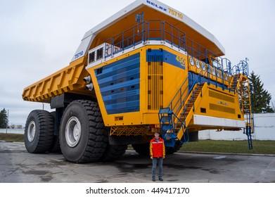 Huge Haul Truck with Man for Scale Copy Space Background.Zodzina, Belarus - March 9, 2016: Haul truck BelAZ 75710 by Belarusian manufacturer BelAZ.