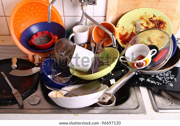 huge heap of dirty dishes waiting for the flatmate
